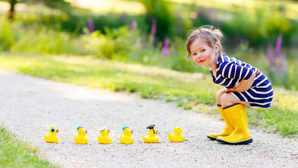 Girl in yellow boot and rubber duckies - Kentucky Dentistry for Kids