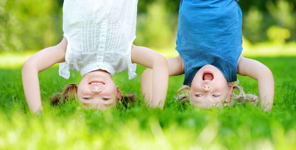 Girls doing headstands - Kentucky Dentistry for Kids
