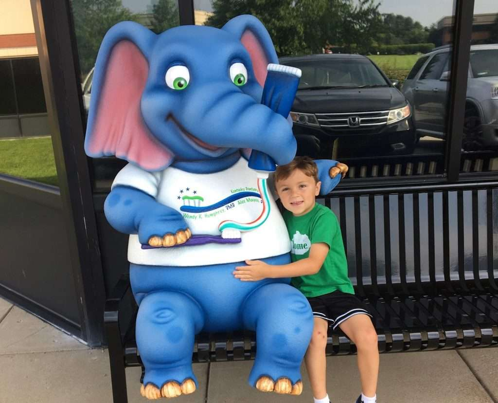 Little Boy with elephant mascot - Kentucky Dentistry for Kids